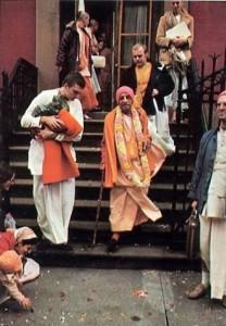 Srila Prabhupada and Hare Krishna devotees descending steps outside ISKCON New York Temple 1974.