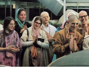 Hare Krishna Devotees bade Srila Prabhupada farewell as he leaves in car from ISKCON New York temple, 1974.