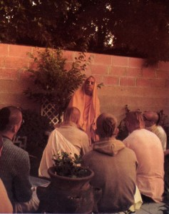 Srila Prabhupada preaching to devotees in his garden at ISKCON New Dvarka (Los Angeles) 1974.