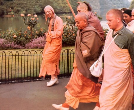 Srila Prabhupada walking with disciples in London, England, 1974.