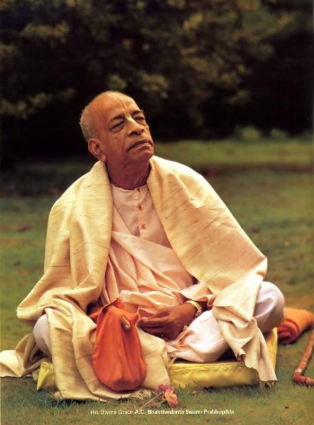 Srila Prabhupada sitting on lawn at Bhaktivedanta Manor, 1974.