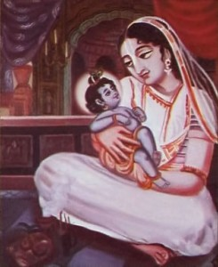 Mother Yasoda with baby Krishna in her lap.