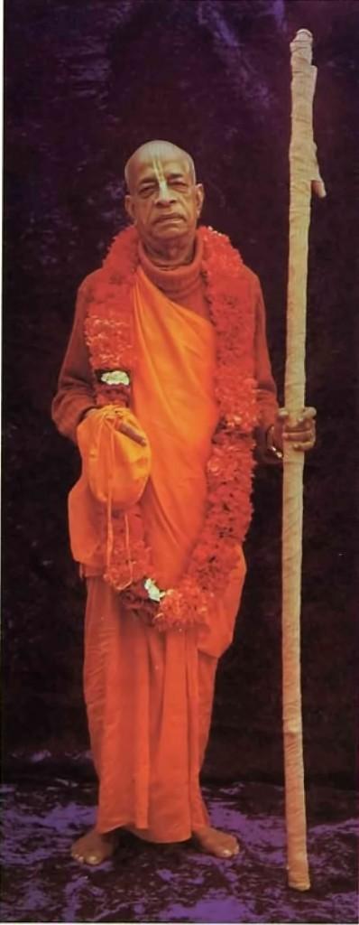 Srila Prabhuapda standing with his sanyasa danda.