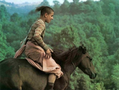 Hare Krishna devotee boy riding horse at New Vrindavan farm community. 1974.