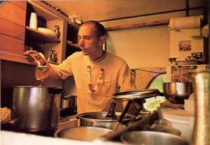Visnujana Swami cooking for Krishna in the kitchen of the traveling party's bus. 1974.