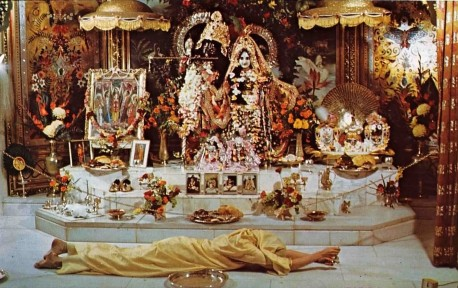 ISKCON Devotee offers Prasadam to Radha Krishna Deities. 1974.