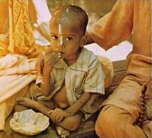 Hare Krishna devotee feed villagers prasadam  Mayapur in West Bengal, India, 1974.