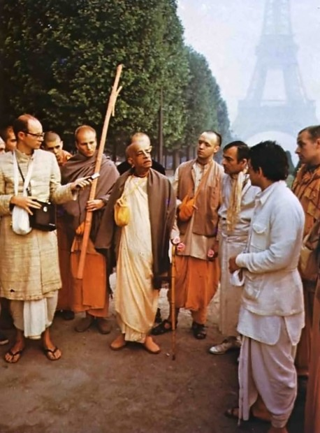 Transcendental words. Srila Prabhupada instructs his disciples during a morning walk in Paris.