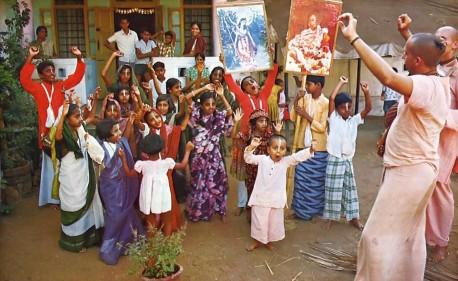Gargamuni Svami leads Bombay Gurukula students in chanting Hare Krishna and dancing. 1975.