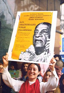 A blissful devotee on a Paris street advertises Srila Prabhupada's forthcoming lecture. 1975.