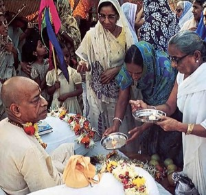Showing respect in an ancient way, ISKCON life members offer lamps at Srila Prabhupada's feet. 1975. Bombay.