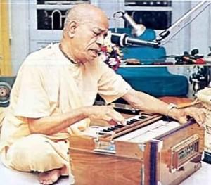 Srila Prabhupada playing Harmonium. 1975.