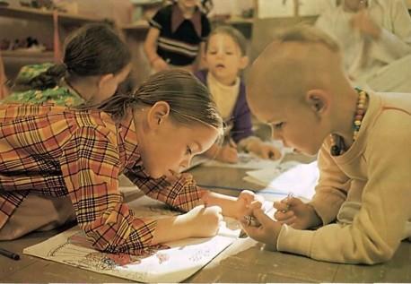 ISKCON Gurukul students coloring pictures of Krishna. Dallas Texas. 1975.