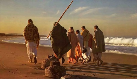 Srila Prabhupada and disciples walking off into sunrise. Venice Beach, CA, 1975.