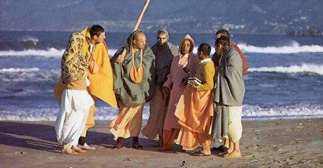 Srila Prabhupada and disciples on morning walk at Venice Beach CA. 1975.