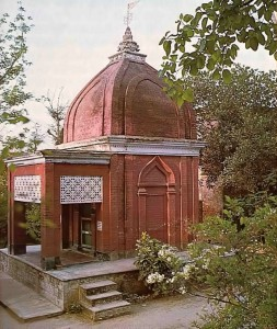 Classic red sandstone tomb of Srila Bhaktivinoda Thakura rests peacefully amidst the palms on the banks of the Jalangi. 1976.