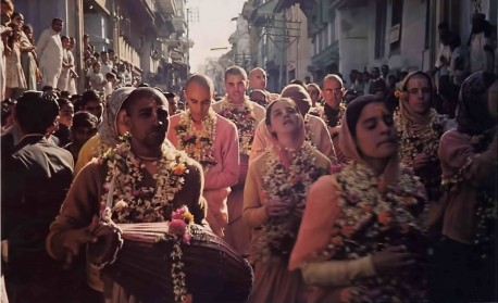 Garlanded by the townspeople, American devotees of Krishna chant His holy names in Surat. 1976.