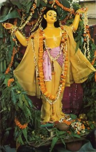 Lord Caitanya Deity poses gracefully during Benares festival commemorating His appearance.