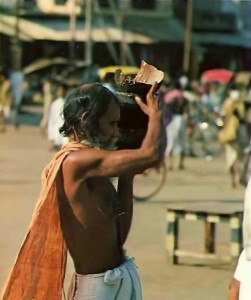 "The bearded brahman carries on his head a ""halfpot"" of rice.- Jagannatha Puri  1976"