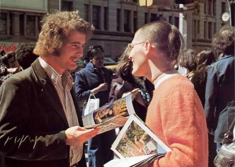 Hare Krishna Devotee sells Back to Godhead Magazines on Street 1976