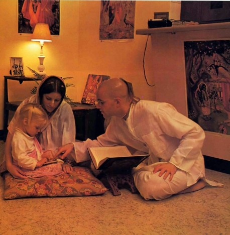 Hare Krishna Devotee with wife and daughter read Bhagavad Gita 1976