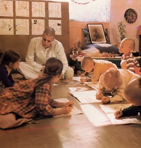 ISKCON Gurukula students studying on floor. 1976.