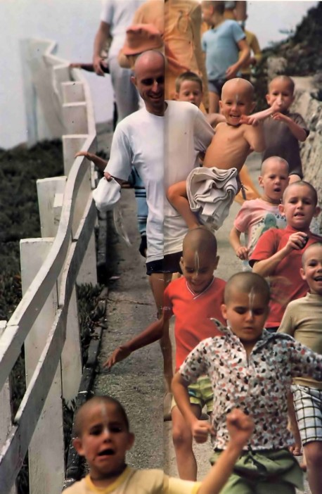 ISKCON Gurukul students and teachers on the way to the beach for a swim. 1976.