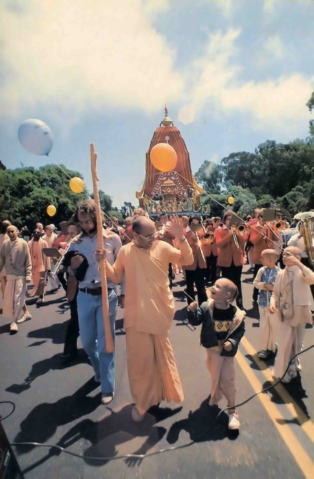 With the band playing a Hare Krishna march (horns and drums to the tune of the maha-mantra), the chariots roll through Golden Gate Park. - 1977
