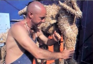 ISKCON devotee makes doll from straw for diorama exhibit - 1977