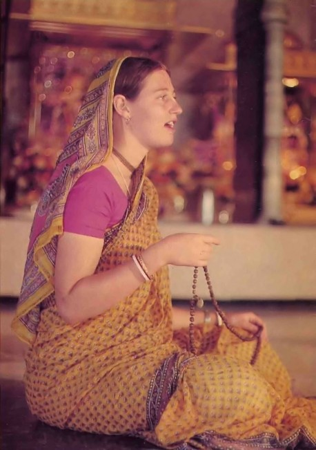 Female Hare Krishna Devotee Sitting in Temple Chanting Hare Krishna on Japa Beads - 1977