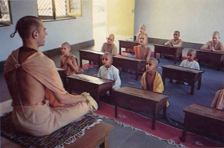 "Headmaster Yasodanandana Swami spends most of his time--both in class and out guiding the boys. Here he's helping some ten-year-olds learn Sanskrit, so that they can dive deep into the ancient Vedas, ""the eternal wisdom."""