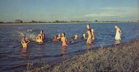 """""""Cleanliness is next to Godliness."""" Lord Krishna used to play in the River Yamuna, so when the boys take their daily swim here they find it marvelously cleansing, for both body and soul. And just as Krishna once sported in the Yamuna's waters, the boys like to horse around and wrestle."""