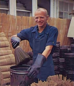 At the Spiritual Sky factory in Los Angeles, Bhaskara dasa dips incense sticks. 1977.