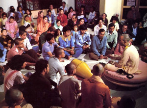 """ Book s are the basis of the Krsna consciousness movement, .. says Pancadravida Svami (giving a class, left) . The sankirtaneros are distributing Srila Prabhupada 's translations of India's Vedic literatures by the thousands. And by the thousands. people are getting firsthand experience of self-realization."
