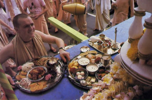 A devotee offers the first plates to Lord Krsna