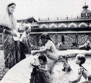 In Limestone, W.Va., young Hare Krishna devotees cool off in fountain in the gardens surrounding the group's Palace of Gold. a memorial to A. C. Bhakti· vedanta Swami Prabhupada. who brought Krishna consciousness to the West.