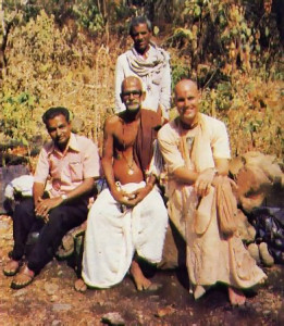 "About to embark on their climb to Ahovalam, lndradyumna Swami (far right) poses with the village brahmana from Lower Ahovalam (center), Mr. T.N. Srinivas(left), principal of Hyderabad's largest public school , and their ""hatchet-guide"" (standing)."