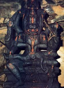 Nrsimhadeva holds on His lap and claws apart the demonic King Hiranyakasipu