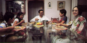 Seated at the dinner table, Nathji and family exchange amusing stories from scripture.