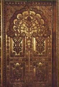 This gold-leafed teakwood door leads to the main hall from Srila Prabhupada's study.