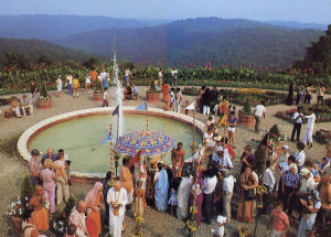 "Devotees and guests mingle by a fountain in the Palace gardens. Srila Bhaktipada, spiritual leader of New Vrindaban, explains that with the Palace New Vrindaban has begun to reveal itself as ""a place of pilgrimage in the Western world, a place where people can come and see spiritual life in action."""