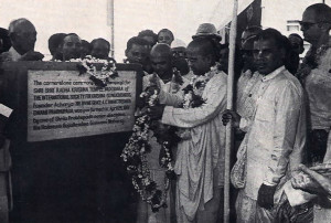 His Holiness Gopala-Krsna Goswami (center. wearing garland and g asses), who oversees the affairs of the Hare Krsna movement in western India, lays the cornerstone of a cultural center the movement is constructing in Baroda. near Bomhay.