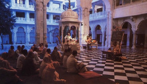 A place of varied spiritual moods. In the early morning devotees gather in the main temple for a class in Vedic philosophy. I n the small pavilion at the back sits an image of Srila Prabhupada. who established Hare Krsna Land. Behind him is the temple's open  courtyard.