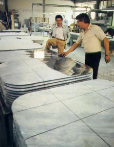 "Marble slabs, cut and shaped for tabletops, receive a final washing, at a Ferrini workshop, one of five near Ponsacco. ""Some of my artisans have become enthusiastic about the hand-crafted pieces for Krsna's temples."" says Marco. ""and they volunteer their services as a devotional offering."""