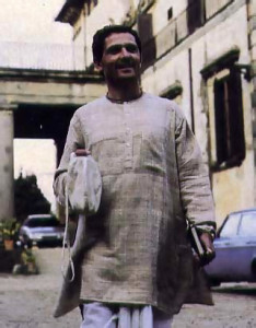 Dressed in traditional clothes and carrying prayer beads, Marco sets off to inspect renovation work on the Krsna farm near Florence