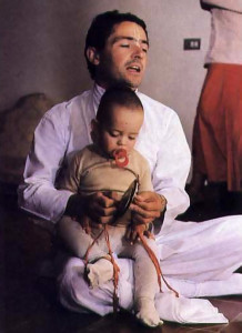 Afterward, Marco chants Hare Krsna with his two-year-old son