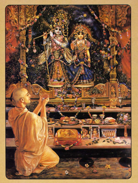 In the temple of Lord Krsna, a devotee presents an offering to the Lord and His eternal consort Radharani.