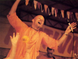 Leaping in ecstasy, the irrepressible Dhrstadyumna Swami leads a number as flowers fly