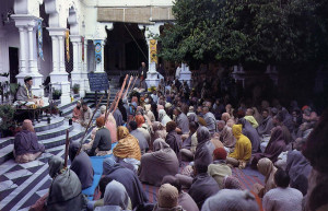 On a chilly morning during this year's festival, devotees hear a class on Srimad-Biragavaram in the temple courtyard.