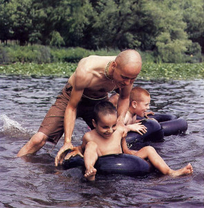 """Frolicking in a lake near the school. """"We grow with these children,"""" says one teacher, """"and we' ll see them through their whole education."""""""